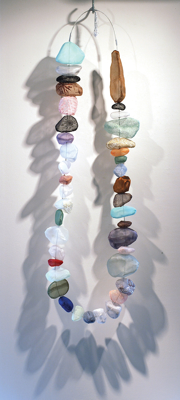 "No Stone Unturned: Rosary to Peace Saberah Malik, Warwick, RI 60 x 16 x 6"" Polyester fabrics, steel cord, thread"