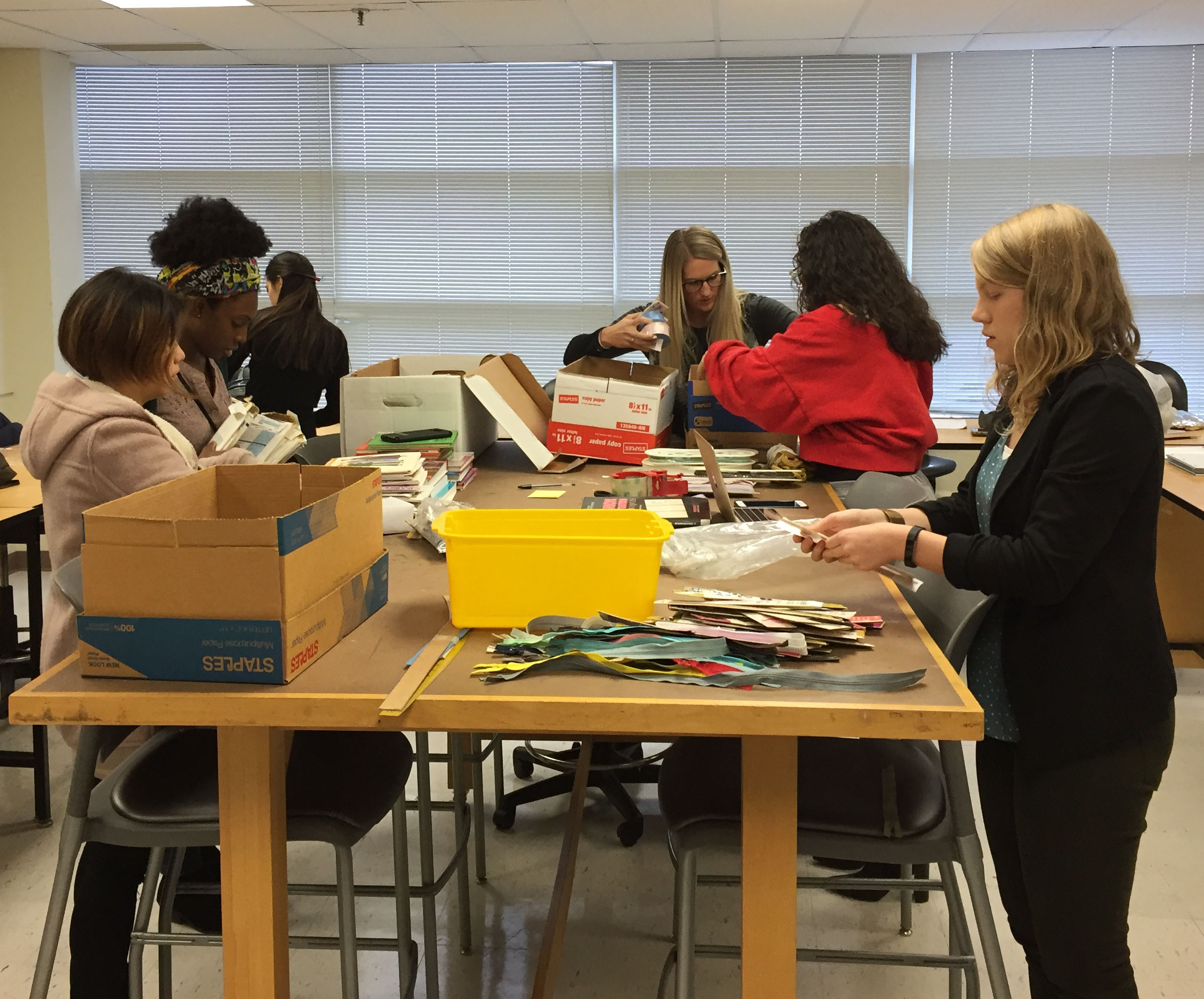 Students from the M.F.I.S. graduate program  packing boxes for Notions for Nigeria Drive