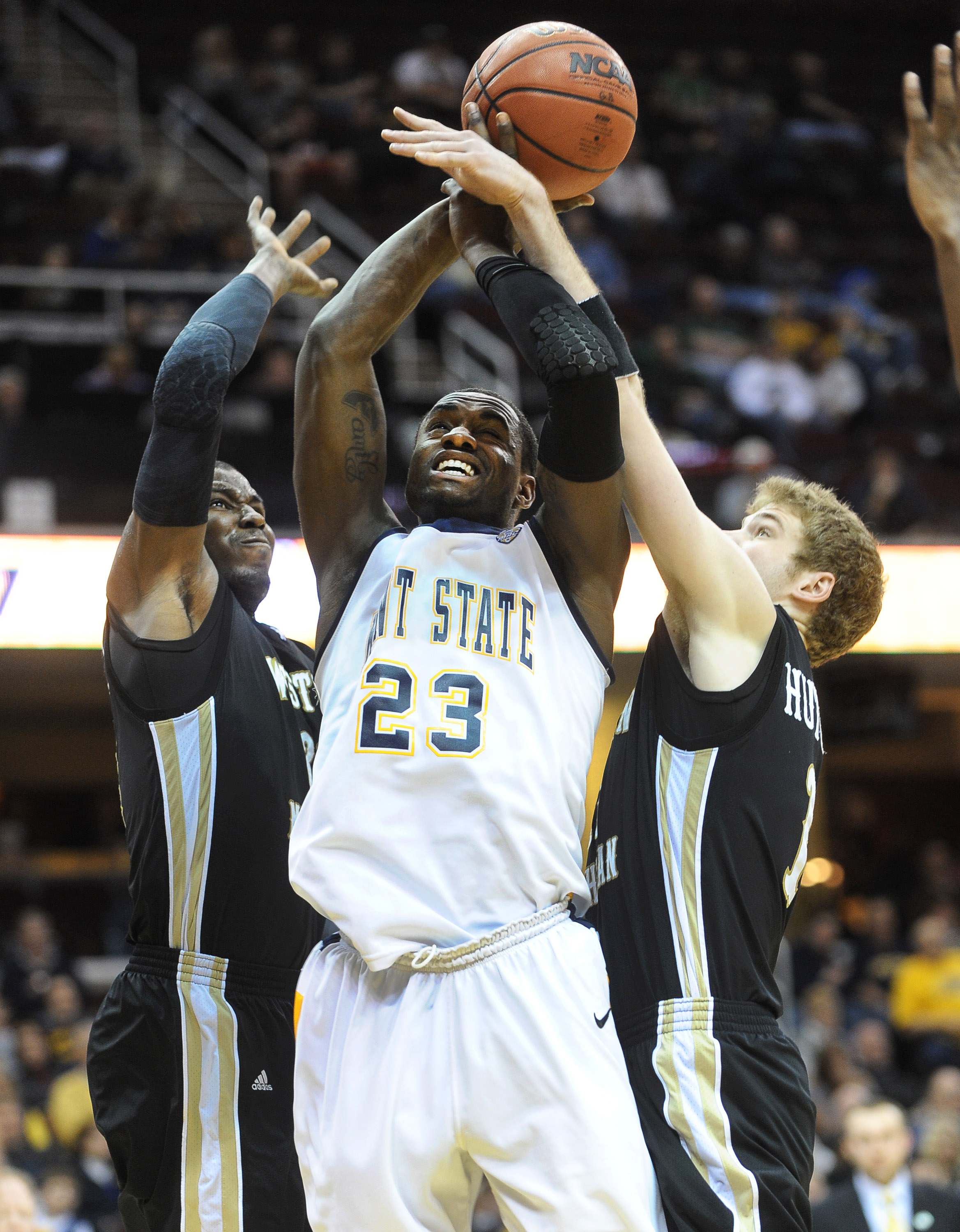 A Kent State player is fouled on the way to the basket during the 2012 MAC Tournament in Cleveland.