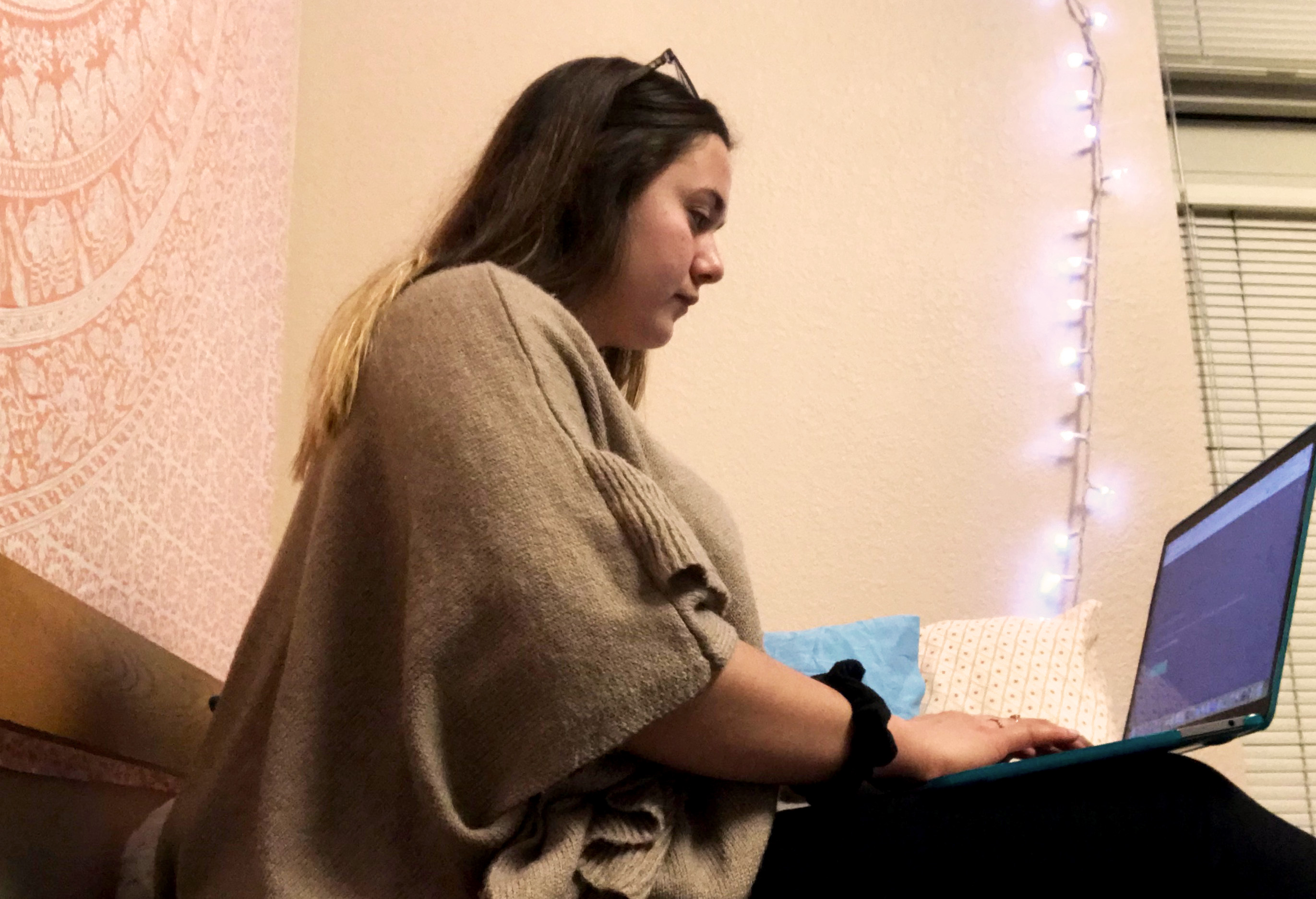 Riley Cummings in her residence hall working on her online course