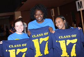 """Kent State University freshman students hold up """"Class of '17"""" shirts they received during a Welcome Weekend event. For the Fall 2013 Semester, Kent State has set a new record, attracting the biggest and highest-achieving freshman class at the Kent Campus in the university's 103-year history."""