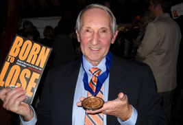 Author James Hollock shows off his IPPY gold medal in one hand and a copy of his award-winning book Born to Lose: Stanley B. Hoss and the Crime Spree That Gripped a Nation in the other. The book, also a finalist for the 2012 American Library Association Awards, was published by the Kent State University Press