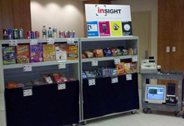 Pictured is the kiosk store that was the 2011 pilot test to prove the concept of the smartphone-based couponing mechanism.The pilot test was conducted with smartphone developer Insight Market Data.