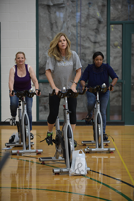 Kent State employees work out at the Student Recreation and Wellness Center.