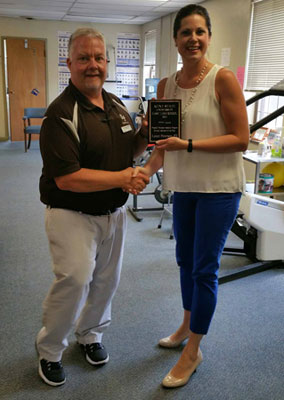 Lance Peterson, manager and physical therapist at Novacare Rehab in East Palestine, received the Clinical Instructor of the Year award from Kathryn Sutton, clinical coordinator and academic advisor for the physical therapist assistant program at Kent State University at East Liverpool.