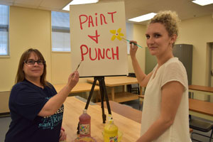 Getting ready for the Paint and Punch event at Kent State East Liverpool are employees (from left) Moneeka Pelley and Ashley Dunlope.