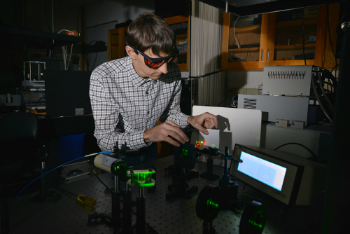 Photo of Kent State graduate student in a lab