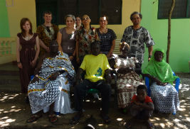 The Kent State group poses for a photo with Nana, chief of the Atonkwa Village in Ghana (seated on the left), and other villagers.
