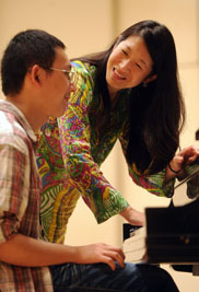 Donna Lee, an associate professor of music and coordinator of the Piano Division at Kent State University, instructs a student at the university's Piano Institute.