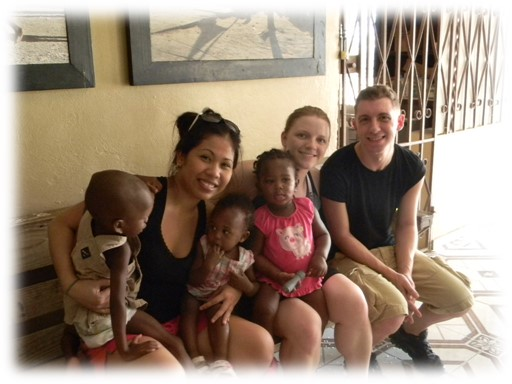 Kent State nursing students Sheila Daniels and Mathew Duck with some of their young patients in Haiti.