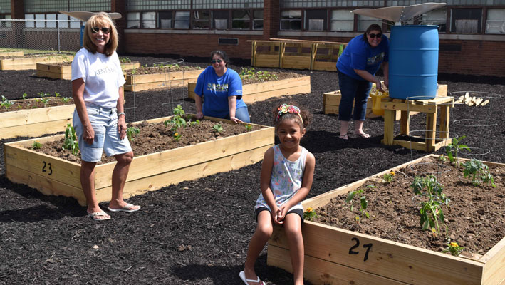 Planting in the Community Garden were (from left) Candy Solterbeck, Dr. Lydia Rose, Megan Rodgers and Enjolie
