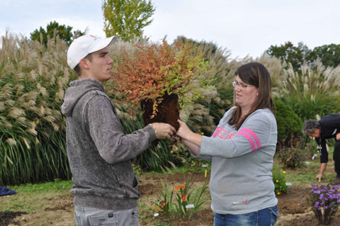 Andy Russell and Samantha Keshock prepare for proper planting