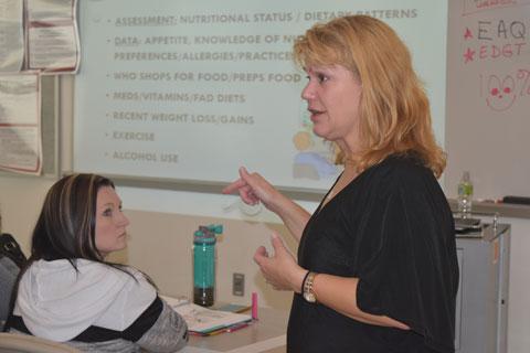 Professor Angela Douglass teaching a class Fall 2016