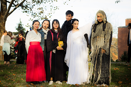 International students at Kent State Stark pose in their costumes as they celebrate Halloween for the first time.