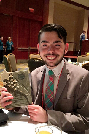 Kent State student Martin Shutzberg spearheaded the award-winning concept presented by Kent State hospitality management students at the Club Managers Association of America World Conference.