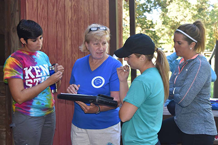 Dawn Speece (center, in blue shirt) instructs volunteers at Focus Hippotherapy before the therapy sessions begin. Olivia Gessler McCullough (in the tie-dye shirt) graduated from the Kent State East Liverpool OTA program in 2013 and continues to volunteer.