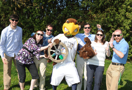 Kent State University mascot Flash and the university's RecycleMania team pose with the Braggin' Wheel, won in last year's informal recycling competition with the University of Akron.