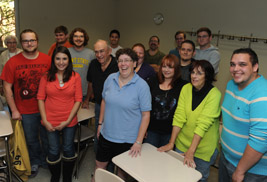 Leslie Heaphy, Ph.D., associate professor of history at Kent State University at Stark, is surrounded by Kent State students and co-workers, following her surprise announcement as recipient of a 2013 Distinguished Teaching Award.