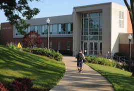 A student walks toward the Fine Arts building at Kent State University at Stark. Theatre performances for the 2013-2014 academic year will be performed at the Kent State Stark Fine Arts Theatre.