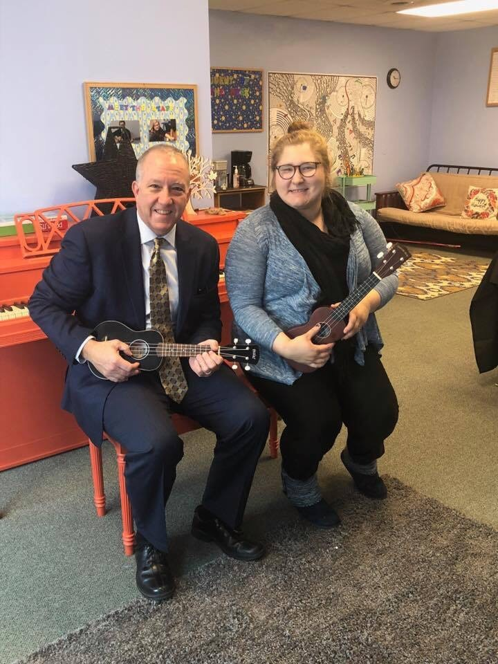 Bethany Westphal playing ukulele with Mayor of Akron Dan Horrigan