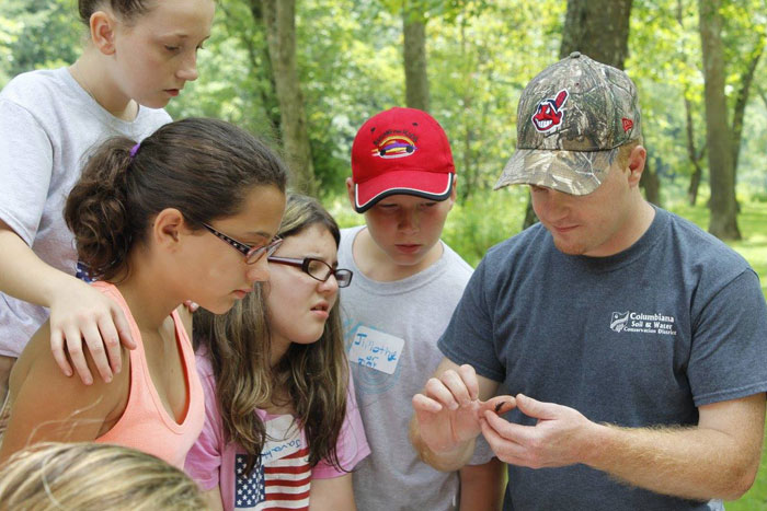 Jason Reynolds of the Columbiana County Soil and Water Conservation District working with the Rural Scholars