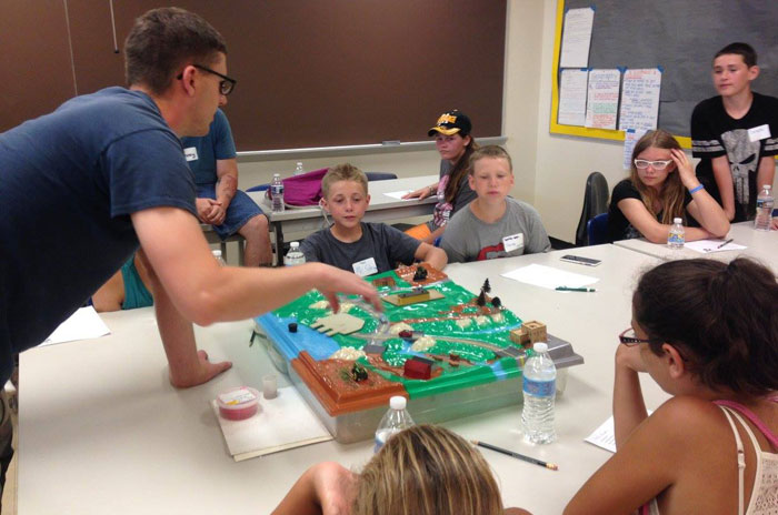 Josh Emanuelson of the Columbiana County Soil and Water Conservation District uses a watershed model to teach Rural Scholars