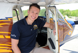 Kent State aeronautics student Ryan Weber works in and around the fleet of Kent State planes at the Andrew Paton Field in Stow, Ohio.