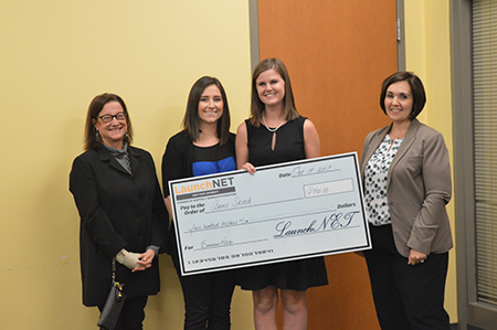 Business​ ​pitch​ ​winner​ ​Anne​ ​Skoch, senior ​fashion​ ​merchandising major,​ poses ​with​ ​the​ ​Elevator​ ​Pitch​ ​2017​ ​judges (from​ ​left)​ ​Marjorie​ ​Wachowiak,​ ​Rachel​ ​O'Neill​ ​and​ ​Kristin​ ​Williams.