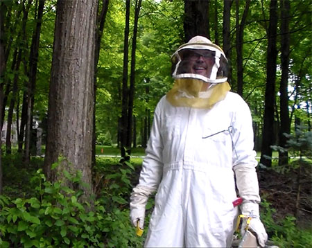 Nathan Ritchey, Ph.D., vice president for Kent State System Integration, wears a beekeeper suit as he engages in one of his favorite hobbies.