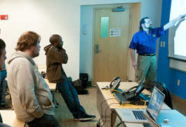 Students in Kent State University's School of Digital Sciences listen attentively during a classroom lecture.