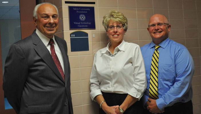 Salem Community Foundation board members (from left) John Tonti and Melissa Costa joined Dean David Dees for the unveiling of the plaque for the Salem Community Foundation Virtual Technology Classroom.