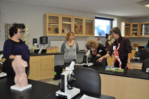 Students are proud to show off the new biology lab to visitors.