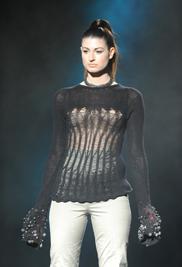 "Kent State fashion design graduate Sylvia Bukowski's collection ""Deco"" is Sylvia's interpretation of Muqarna, a specific, comb-like pattern found in Islamic architecture."