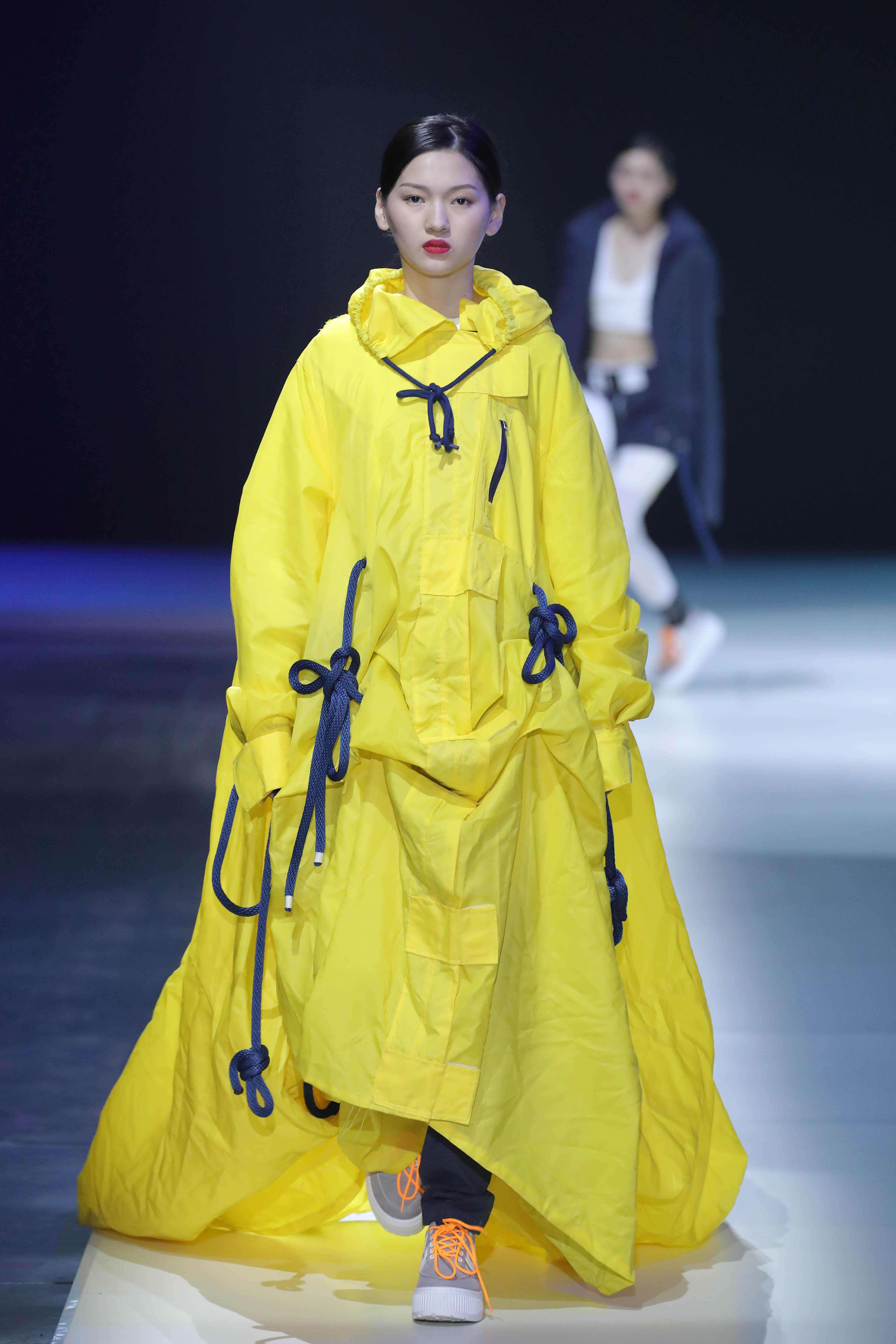 Model walking the runway during the 2018IYDC in China