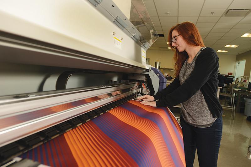 Girl using textile printer