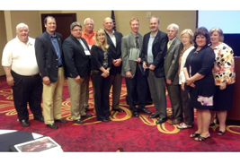 Kent State and city of Kent representatives were in Buffalo, N.Y., earlier this month to accept the Larry Abernathy Award from the International Town-Gown Association (ITGA). The award honors the town-gown relationship that best represents the spirit of ITGA.