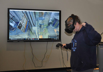 "A student ""walks the plank"" during a virtual reality exercise"