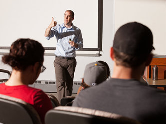 A Kent State University College of Business Administration professor teaches a class.