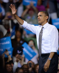 President Obama greets the crowd at the MAC Center.