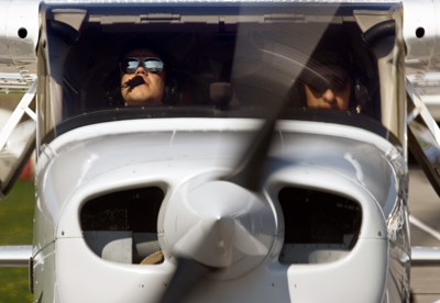 Two pilots preparing for takeoff