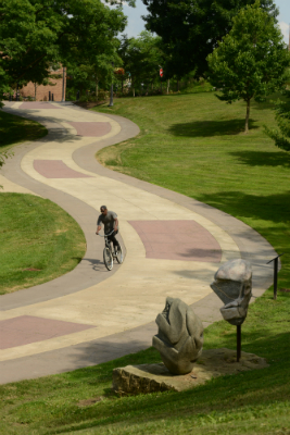 Bicycle riding on campus walkway