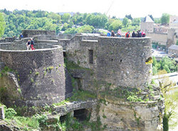 People walking on castle ruins in study abroad trip