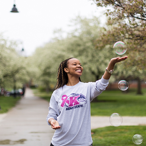 Student playing with bubbles