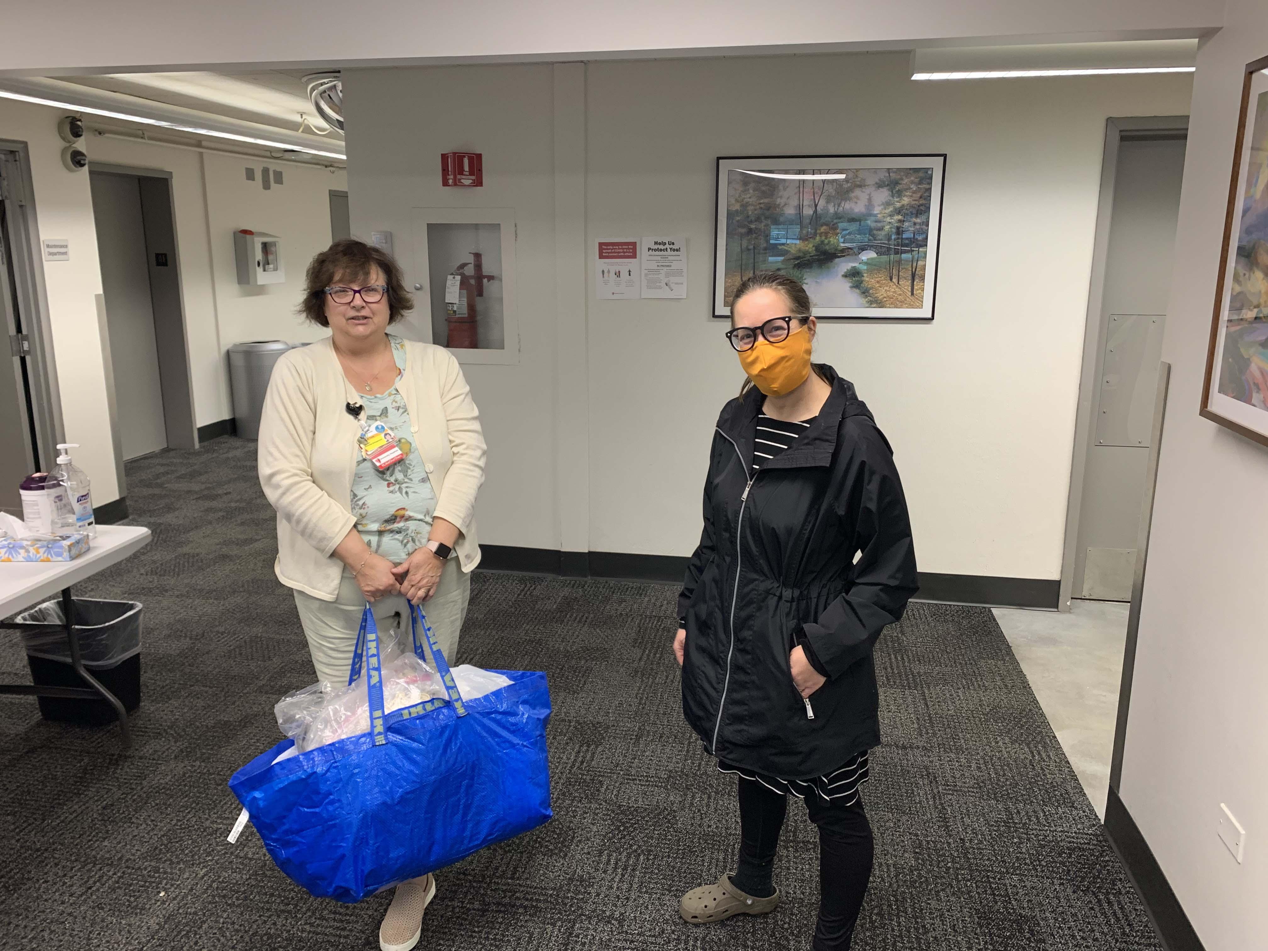 Professor Linda Ohrn-McDaniel Delivers a batch of Masks to University Hospital.