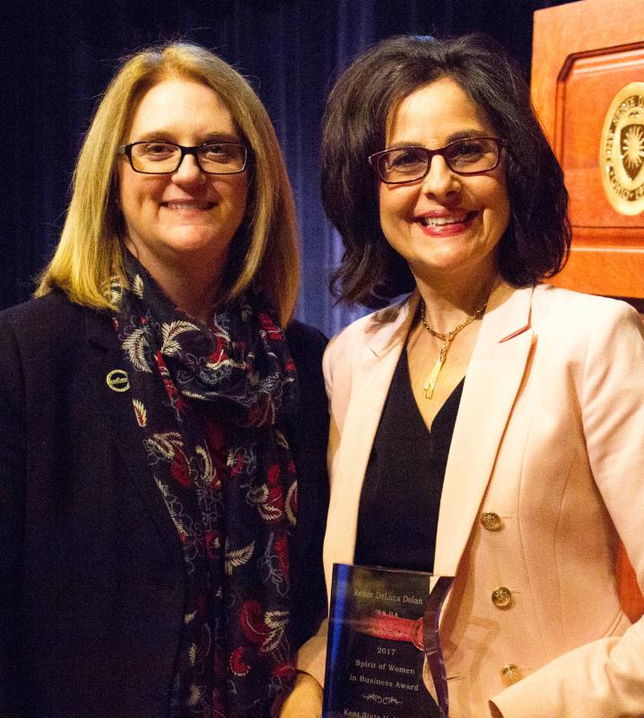 Two women stand smiling during the 2017 Spirit of Women in Business Conference hosted by the College of Business Administration at Kent State University.