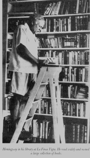 Ernest Hemingway in his library
