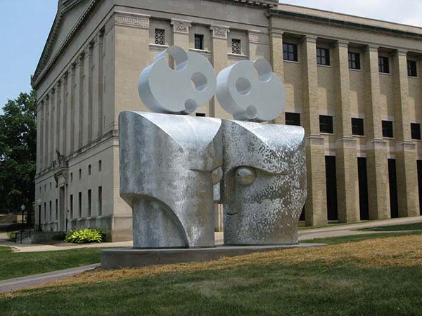 """Eye To Eye"" by artist Barry Gunderson is located in front of Kent Hall along the University Esplanade on Hilltop Drive"
