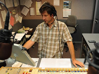 Jeff St. Clair, Morning Edition Host at WKSU, prepares for the morning program.
