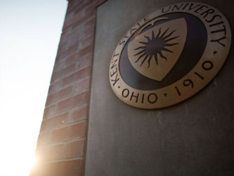 The Kent State University seal on the side of a building on campus.