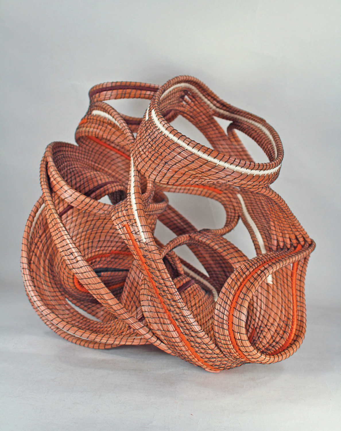 """Enigma Peggy Wyman, Macomb, MO 15 x 15 x 13.5"""" Long-leaf pine needles, Irish waxed linen, pearl cotton and wire,  using the techniques of coiled basketry"""